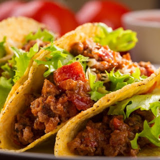 Slow Cooker Ground Beef And Refried Bean Tacos.