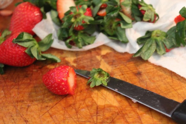 Rinse & clean the strawberries, cutting off the stems & any part that is...