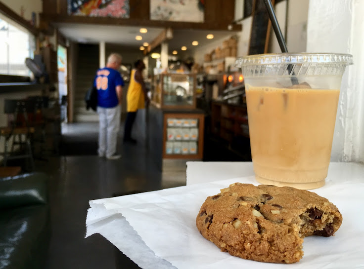 Iced coffee and a chocolate chip walnut cookie.
