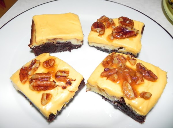 Once you remove your brownies from oven let cool and then ice. Top with...
