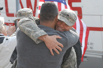 Photo: Sgt. Carlon Oliver, returning OMLT member, greets family and friends.  The twelve Soldiers making up the Operational Mentoring Liaison Team (OMLT) from the Minnesota Army National Guard returned to Minnesota from a one-year deployment to Afghanistan in support of Operation Enduring Freedom on Nov. 6.