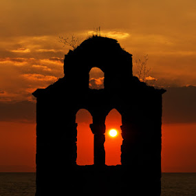 Sunset through the ruins... by Elias Spiliotis - Buildings & Architecture Public & Historical ( clouds, church, greece, sea, sun, shadows, traveling, sunset, clouds formation, buildings, ruins, post-byzantine, landscapes, religious,  )