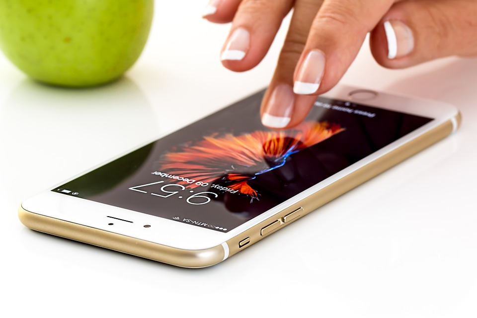 Woman fingers browsing on smartphone