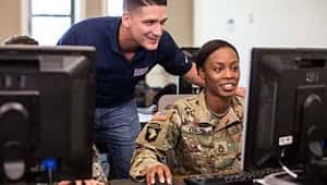 USO Pathfinder Scout witha a transitioning service member at the USO Center