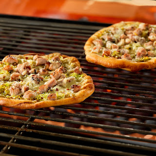 Grilled Pizzas with Herbed Pork and Brussels Sprouts.