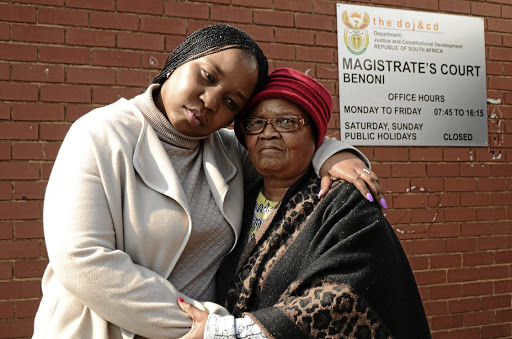 Nomava Dire, the daughter of the late Senkubele Dire, with her aunt Gabantathe Dire, outside the Benoni Magistrate's Court yesterday where they were attending a case of two suspects found with the late doctor's car.