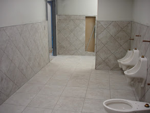 Photo: 20x20 porcelain tile on floor W/ 13x13 diagnal installlation on walls