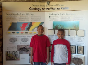 Photo: Jihad & Q in front of the geology exhibit