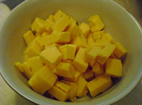 If using Velveeta cheese, cube the cheese and set aside.