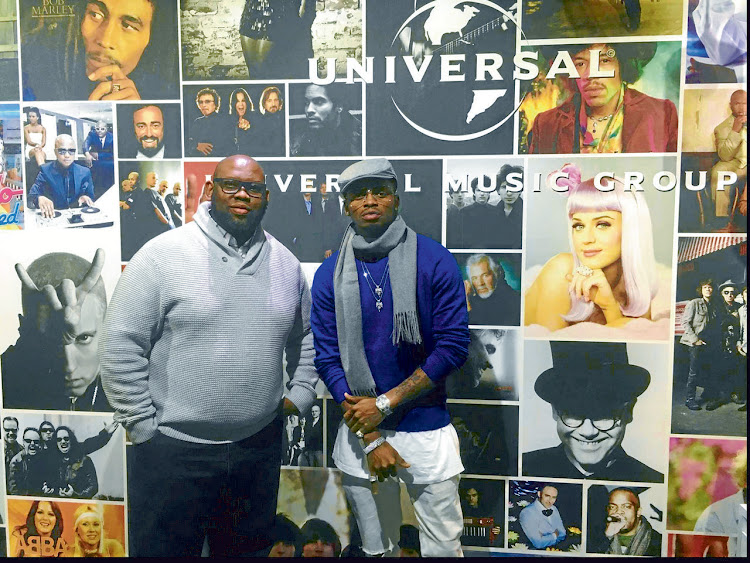 Tanzanian great Diamond Platnumz (right) signs with Universal. Picture: SUPPLIED