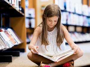 Little girl reading chapter book