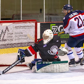 Big save. by Yves Sansoucy - Sports & Fitness Ice hockey