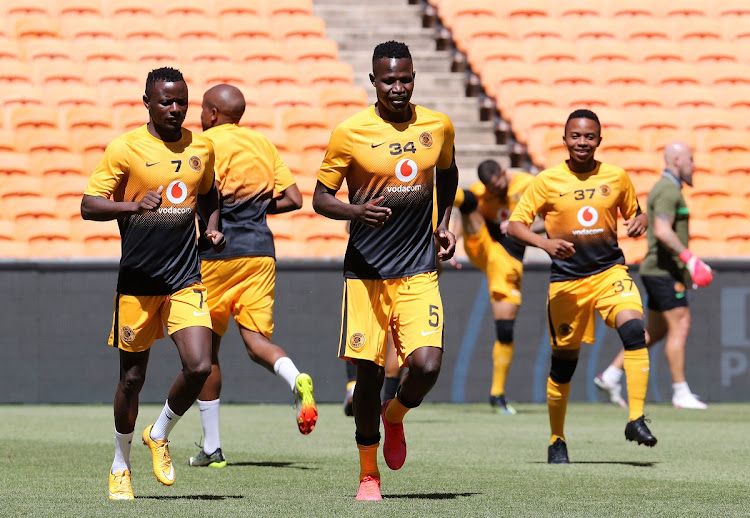 Anthony Akumu Agay with Lazarous Kambole of Kaizer Chiefs run on the field before a Premiership match between against SuperSport United at FNB Stadium on February 20, 2021 in Johannesburg.