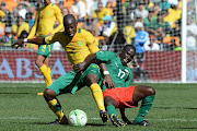 Hlompho Kekana of Bafana Bafana and Barro Sidiki during the International Friendly match between South Africa and Burkina Faso at FNB Stadium on August 17, 2013 in Soweto, South Africa. (Photo by Lefty Shivambu/Gallo Images)
