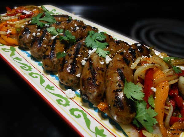 Grill brats till done, grill veggies.  Place on Mission Brand Low carb tortilla...
