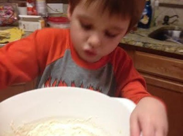 Add the raisins and buttermilk or milk.  Stir by hand with a wooden...