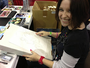 Photo: Val Hochberg doing a commission sketch at the WFC booth.