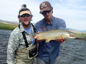 Photo: Brian and John McClure with a big brown from the Madison