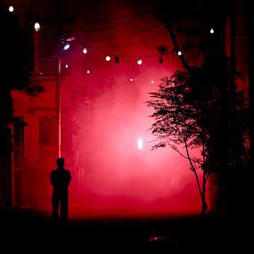 Red Smoke by Mriganka Sekhar Halder - Landscapes Starscapes ( red, shadow, silhouette, road, smoke, man )