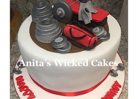 Gym weights themed birthday cake