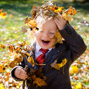 Falling Leaves on Boy by Winterlyn Stebner - Babies & Children Children Candids ( orange, laughing, park, colorful, autumn, green, happy, fall, child portrait, happiness, leaf, boy )