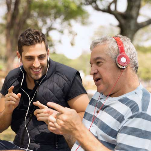 son listens to music with dad