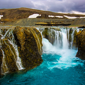 The Waterfall of Landmannalaugar! by Avishek Patra - Landscapes Waterscapes ( canon, stream, europe, mountain, flowing, colorful, waterfall, cliff, scenic, travel, landscape, island, contrast, landmannalaugar, iceland, nature, cascade, akpphotography, photographer, blueandwhite,  )