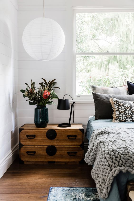 paper lanterns in a white bedroom