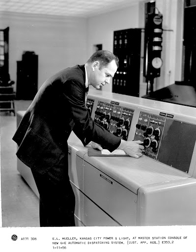 E.L. Mueller, Kansas City Power & Light, at master station console of new G-E automatic dispatching system. (Cust. App. Req.)