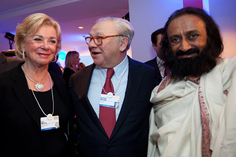 Photo: DAVOS, SWITZERLAND - JANUARY 25:  Liz Mohn, DLD Chairman Hubert Burda and Ravi Shankar attend the Burda DLD Nightcap 2011 at the Steigenberger Bellvedere hotel on January 25, 2012 in Davos, Switzerland. DLD (Digital - Life - Design) is a global conference network on innovation, digital, science and culture which connects business, creative and social leaders, opinion-form science and culture which connects business, creative and social leaders, opinion-formers and investors for crossover conversation and inspiration.  (Photo by Nadine Rupp/Getty Images)