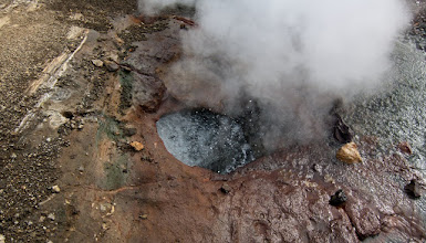 Photo: A fumarole (Latin fumus, smoke) is an opening in a planet's crust, often in the neighborhood of volcanoes, which emits steam and gases such as carbon dioxide, sulfur dioxide, hydrogen chloride, and hydrogen sulfide. The steam is created when superheated water turns to steam as its pressure drops when it emerges from the ground.