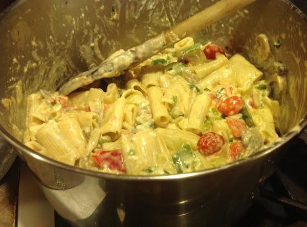 Now add the pasta, grape tomatoes, drained sliced mushrooms & Italian seasoning  in...