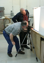 Photo: Hal Burdette photographing in his newly-constructed Phrugal Photo Studio while Mike Colella looks on.