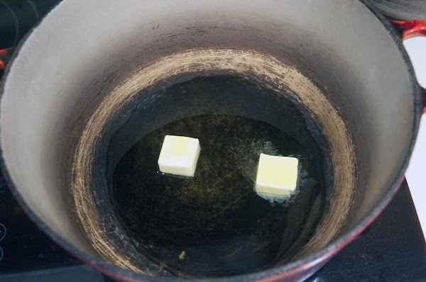 In a large Dutch oven over medium heat, add the butter and olive oil.