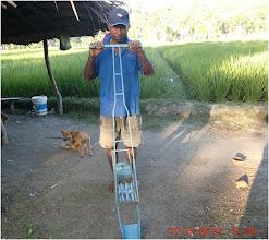 Photo: SRI farmer Valentino Pareira with a self-made weeder, 6/26/2010. [Photo Courtesy of Iswandi Anas]