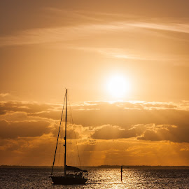 Evening Float by Kevin Frick - Transportation Boats ( sunset, rays, boat )