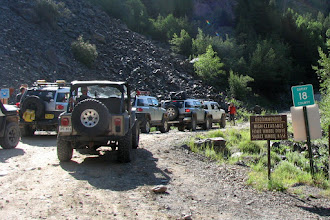 Photo: OURAY BOUND! Lots of people lined up to go over a VERY steep pass. Another group of Toyota, Dan leads us pass the group to start our journey!