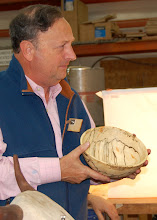 Photo: Stan shows a spalted bowl that he is not sure what the wood is.