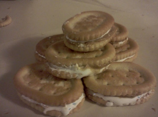 Melt the chocolate according to package directions. Put peanut butter on one cracker and...