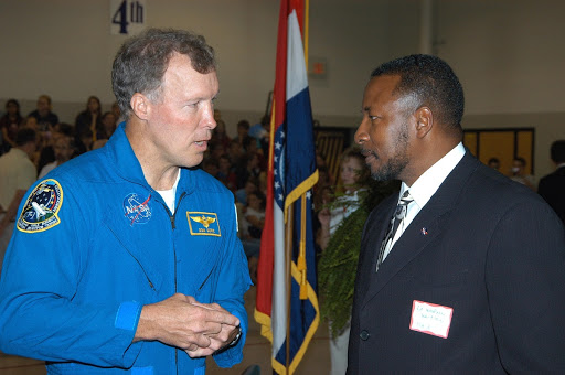 Dom Gorie left talks with KSC Deputy Director Dr. Woodrow Whitlow during a visit to Trojan Intermediate School.