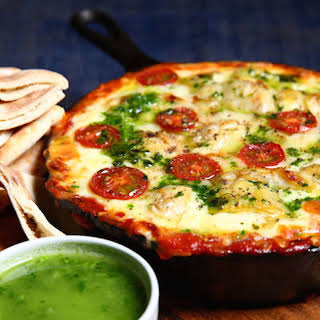 Last Minute New Year's Snack Alert! Make this Cheesy Hummus Pizza Dip With Basil Oil.