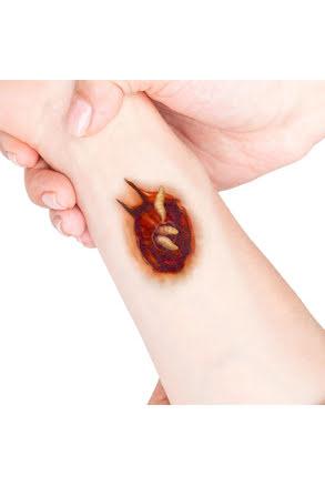 Tatuering sår, larver