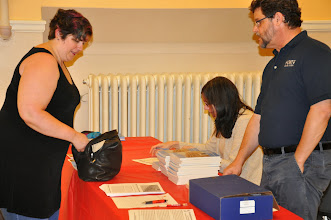Photo: Dawn-Marie Oliver picks up her copy of the anthology.