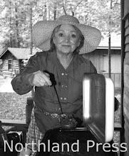 Photo: Crosslake Historical Society - Marsha Schoeb of the Crosslake Historical Society served up Lumberjack Chili - photo by Paul Boblett