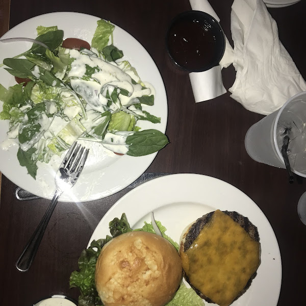 I ordered a side salad with no croutons and the O'Neil's burger with bbq. It was very good especially the bun and very filling I did not get any effect from gluten. No specific gf menu.