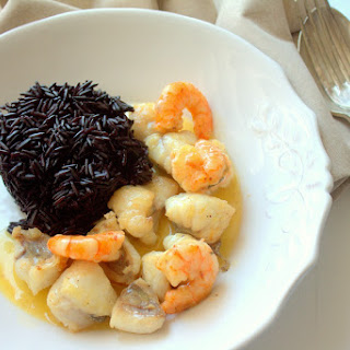 Camarga Black Rice with Monkfish and Prawns in Lemon Sauce.