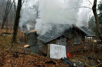 Photo: Norm Cummings SPECTRUM/A building at the former Boy Scout camp at Mill Pond in Sherman is burned as a firefighters' drill, Jan. 13, 2007
