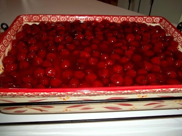 Spread on the cherry topping and refrigerate until chilled and ready to serve. I...