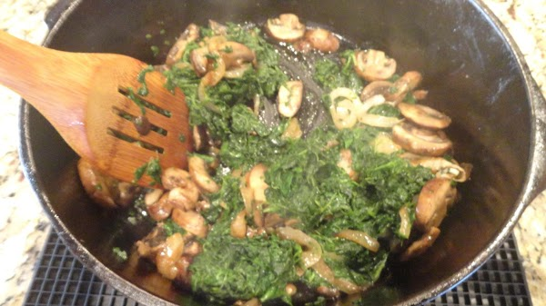 Cook chopped spinach in a saucepan in water until heated through (water boils) stirring...