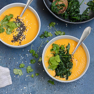 Spicy Carrot Soup with Tahini and Garlicky Greens.